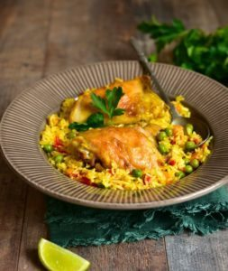 chicken recipe image, Pollo Arvejado over a bed of saffron rice