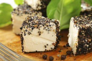 Fresh cheese rolled in black pepper