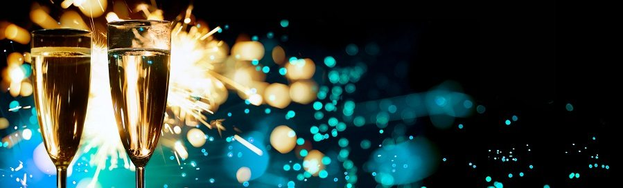 Champagne Glasses Infront Of Fireworks – New Year