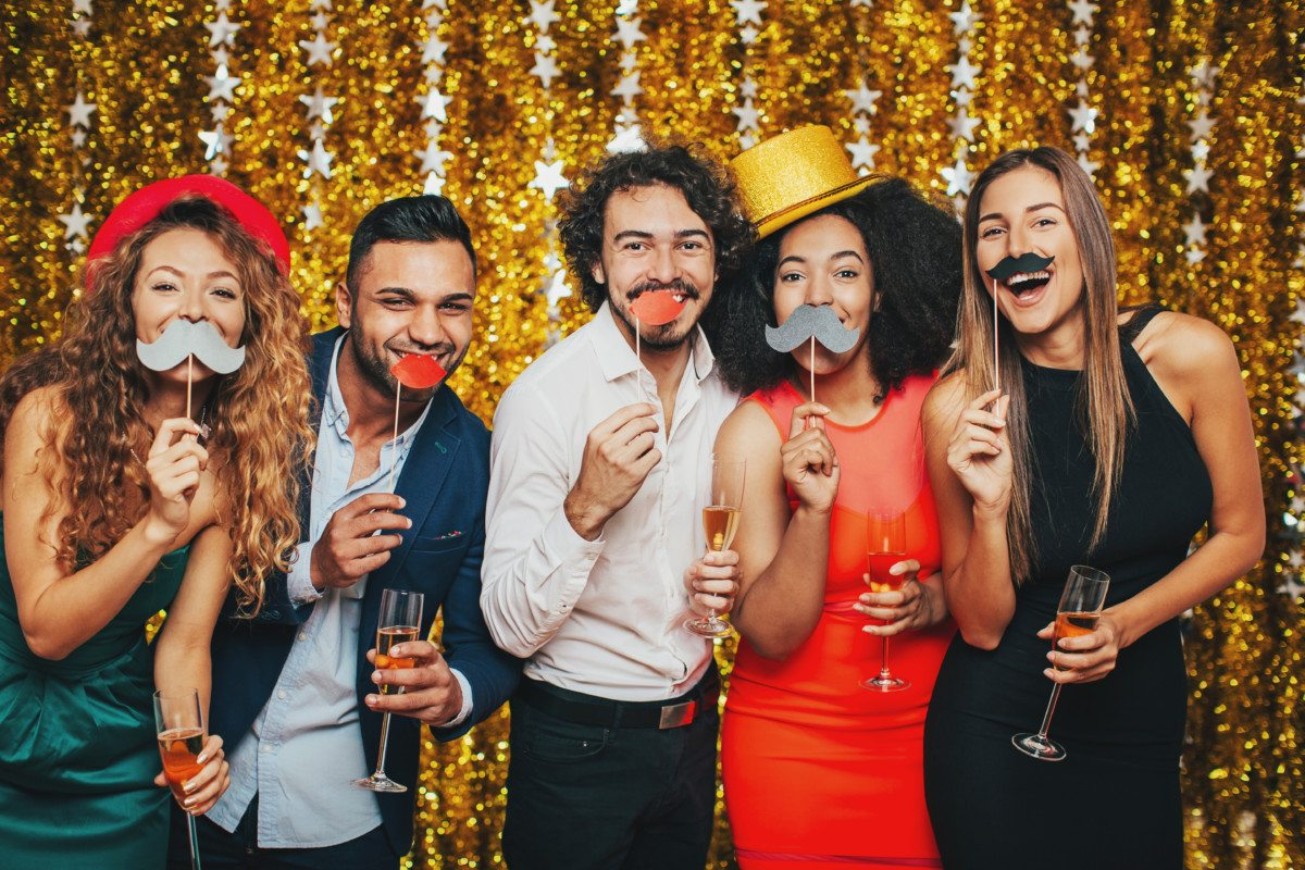 Multi-ethnic group of people having fun and drinking champagne on a formal party.