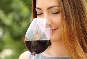 woman sniffing glass of wine